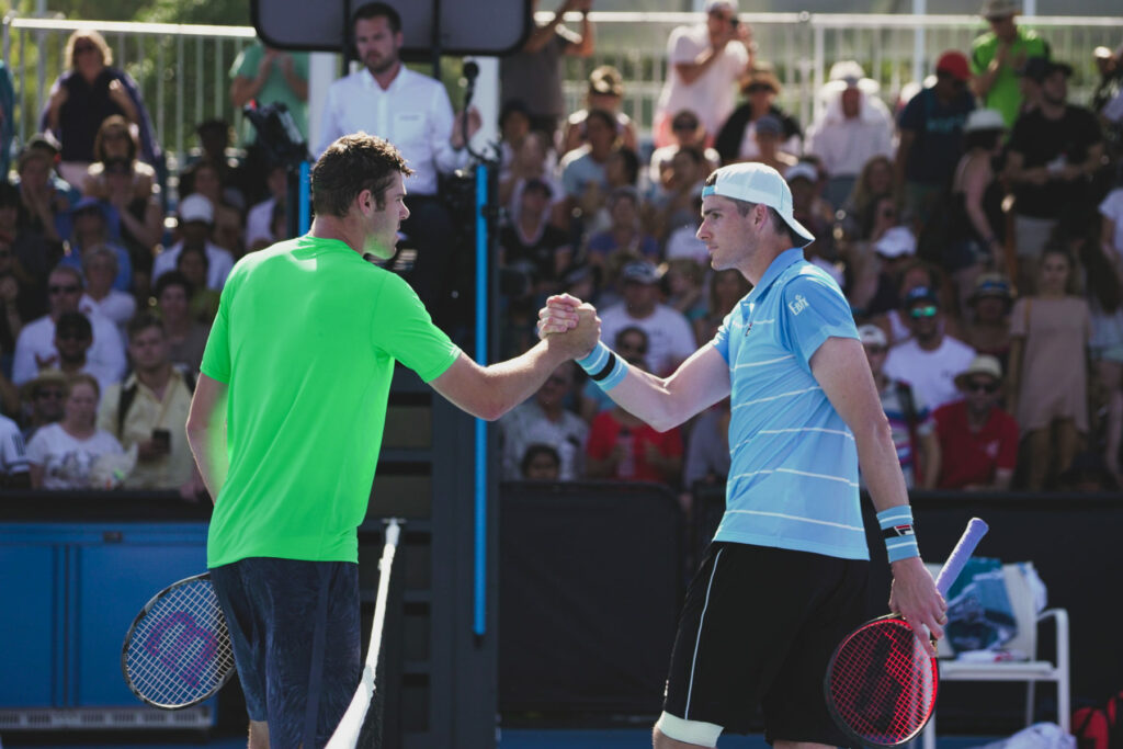 "Reilly Opelka 7ft and Jon Isner 6ft 10"" shake hands after 1st round matchup in Australian Open 2019"